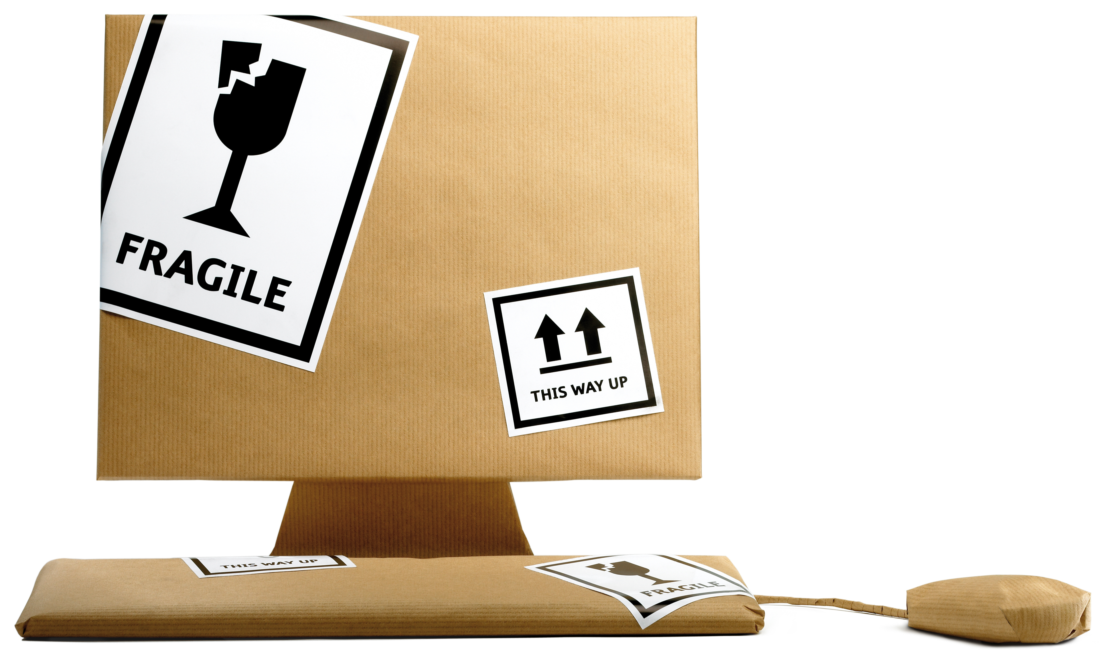 Image of computer, keyboard and mouse wrapped up in brown paper reading fragile
